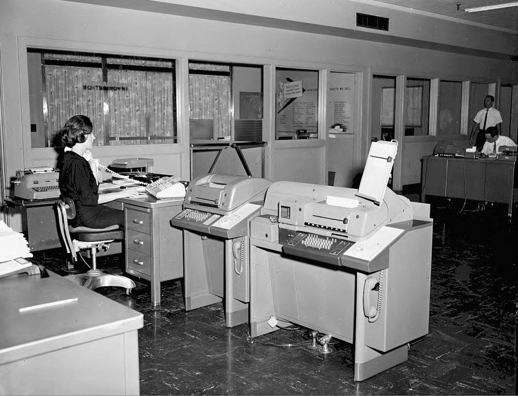 Teletype Machines at the Southern Bell Telephone & Telegraph Company Office on August 7th, 1964 - Georgia State University Library