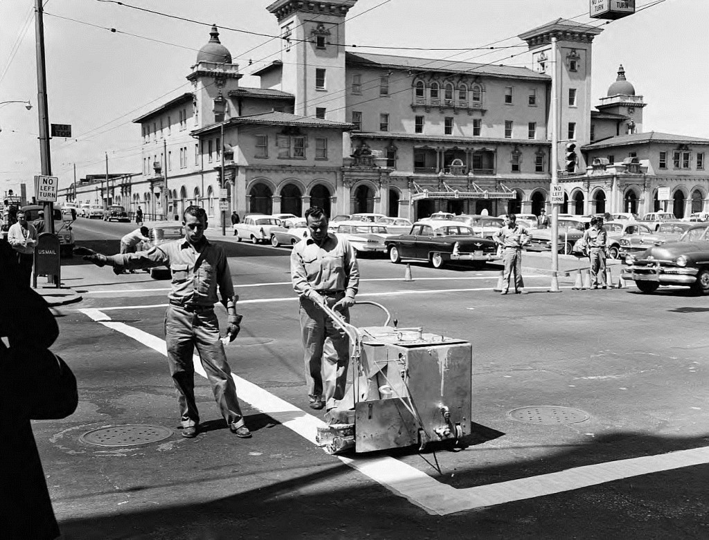 Terminal Station with Men Painting a Crosswalk on Spring Street on March 31, 1960 - Georgia State University Library