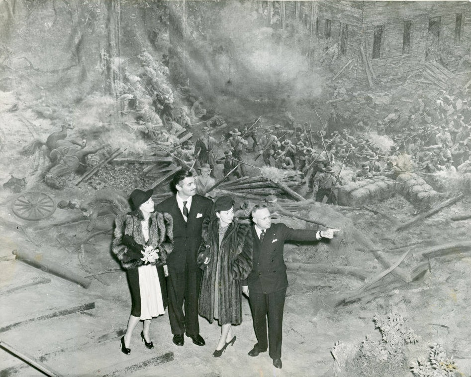 Gone with the Wind cast members Vivien Leigh, Clark Gable and Olivia DeHaviland touring the Atlanta Cyclorama with George Simons from the Atlanta City Parks Department on December 16th, 1939 - Georgia State University Library