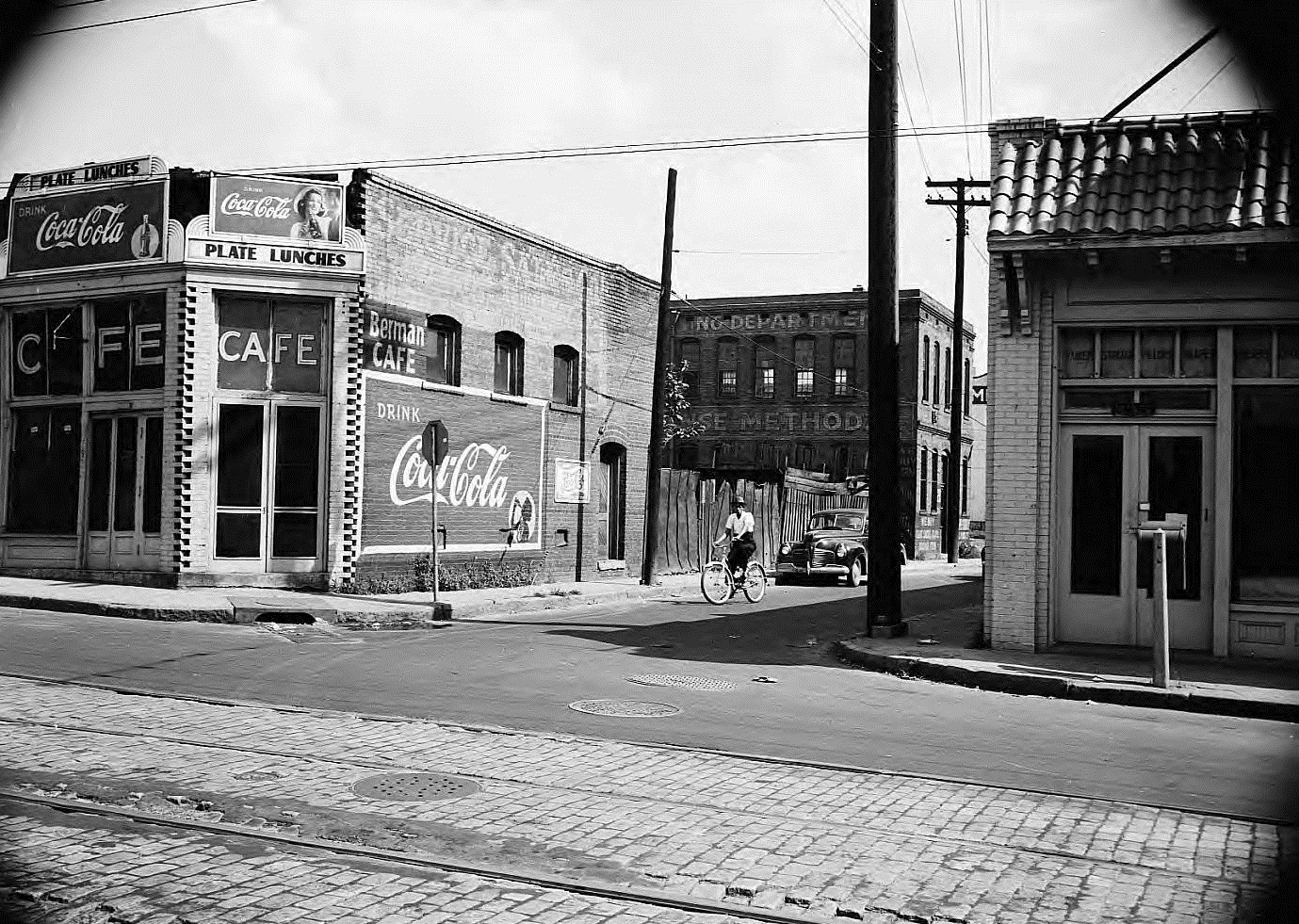 A Picture from the 1940's or 1950's taken from Edgewood Avenue showing the Trio Laundry Building in the background - Georgia State University Library