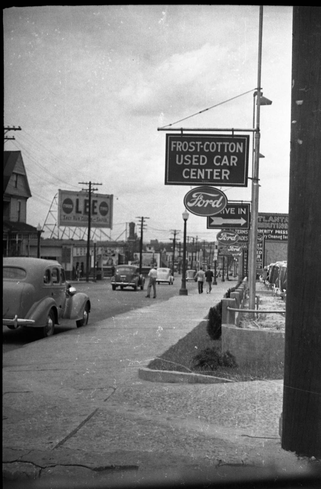 Signage along Spring Street in Atlanta in the 1930s - Georgia State University Library