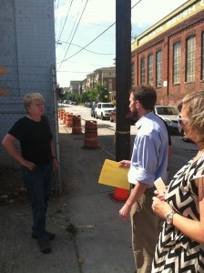Local architect and activist Kyle Kessler talking with others at the Trio Laundry Building - It was mostly through his efforts this building demo was halted in late August 2014 - Photograph Courtesy of Paul Hammock