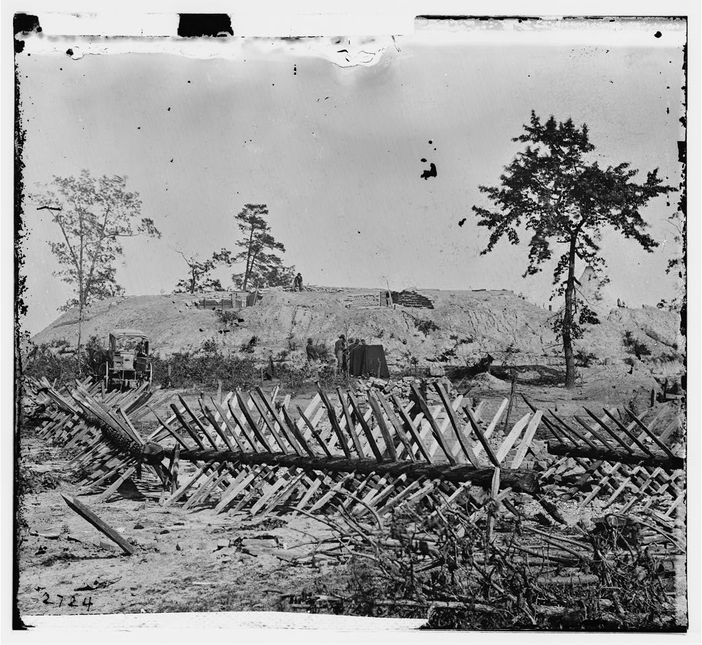 A possible image of Fort X aka Fort Hood - Behind the chevaux-de-frise on Marietta Street we see photographic wagons, a darkroom and a fort - U.S. Library od Congress